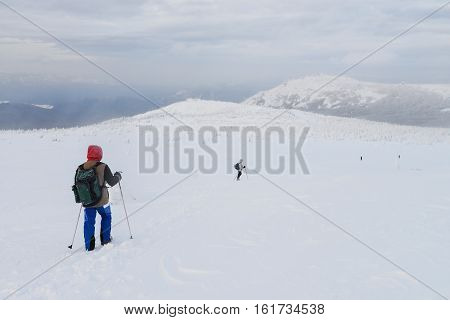 Group of hikers in winter mountains, Russia, Ural