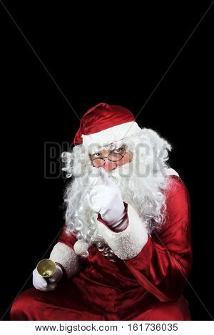 Santa Claus With Bell In his hand Isolated On Black Background