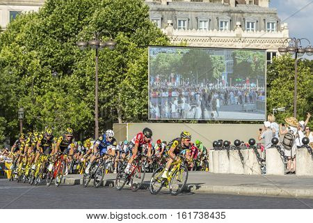 Paris France - July 24 2016: Thomas Voeckler of Direct Energie Team and Thomas De Gendt of Lotto-Soudal Team in fornt of the peloton passing by the Arch de Triomphe on Champs Elysees in Paris during the latest stage of Tour de France 2016.