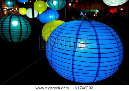 colorful balloon paper lamps isolated on black background