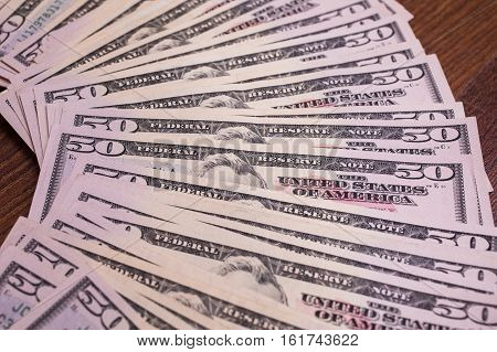 background of the money fifty dollar bills front side face. background of dollars millionaire businessman
