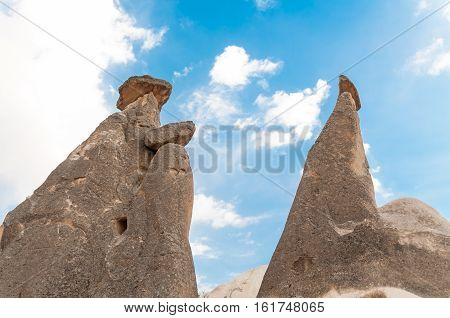 Stone Chimneys With Artificial Caves Near Goreme In Cappadocia, Turkey