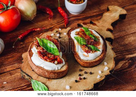 Two Bruschettas with Sundried Tomatoes and Spicy Sauce with Red Pepper