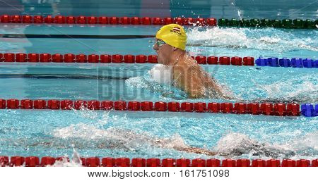 Hong Kong China - Oct 30 2016. Competitive swimmer STEFFAN Sebastian (AUT) swimming breaststroke in the Men's Breaststroke 100m Preliminary Heat. FINA Swimming World Cup Victoria Park Swimming Pool