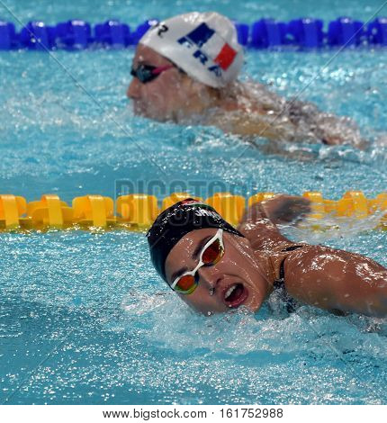 Hong Kong China - Oct 30 2016. Competitive swimmer Zsuzsanna JAKABOS (HUN) and WISHAUPT Camille (FRA) swimming butterfly. FINA Swimming World Cup Preliminary Heats Victoria Park Swimming Pool.
