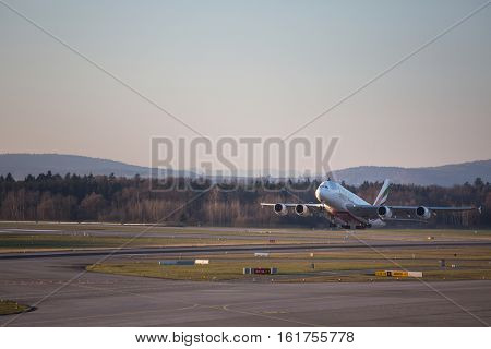 ZURICH - December 3rd 2016: Emirates Airbus taking off at the Zurich International Airport (Flughafen Zurich) in Kloten, Switzerland