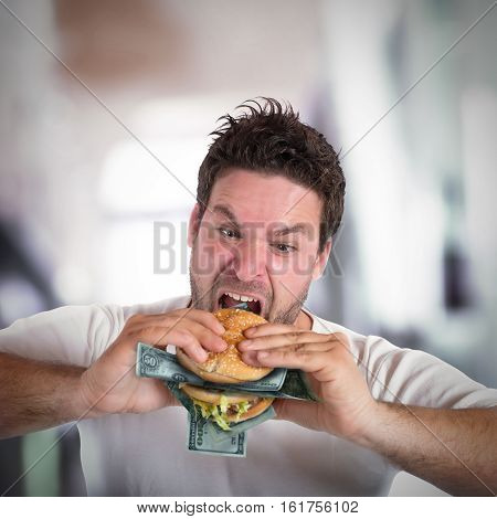 Greedy and fat businessman eats a sandwich with banknotes