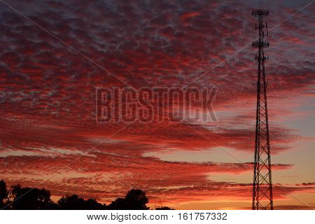cell tower caught in a beautiful sunset
