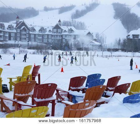 Now blizzard. Winter activity. Chairs under snow.