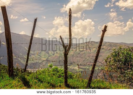Old Wood Fence Posts With Barb Wire Aerial View Of Andean Cordillera In The Background Ecuador South America