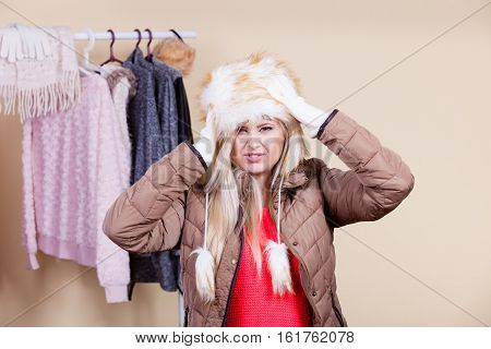 Woman In Furry Hat Thinking What To Wear
