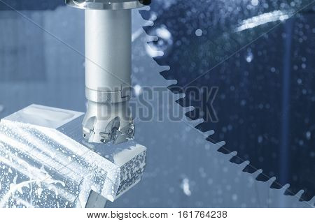 The abstract scene of cutting tool on CNC's milling machine and circular saw blade in light-blue effect.
