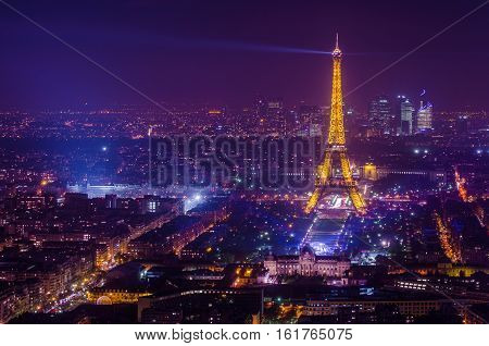 Paris, France - SEPTEMBER 2016. Eiffel Tower in night. Famous historical landmark on the quay of a river Seine.