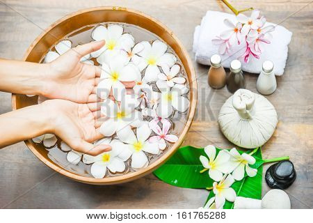 Spa Treatment And Product For Hand Spa With Flowers And Water, Wooden Background; Select And Soft Fo