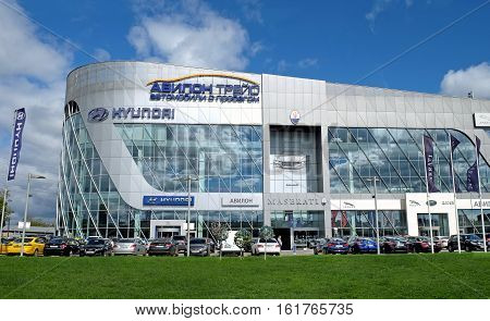 MOSCOW RUSSIA - AUGUST 26 2016: Modern building in the architectural style of high-tech on the Moscow Ring Road. Shops selling cars