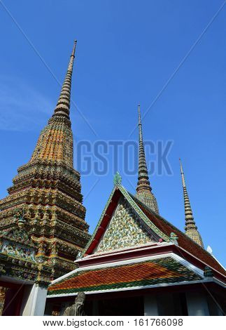 Pagoda and pavillion in Thai temple with blue sky background Wat Pho Bangkok Thailand