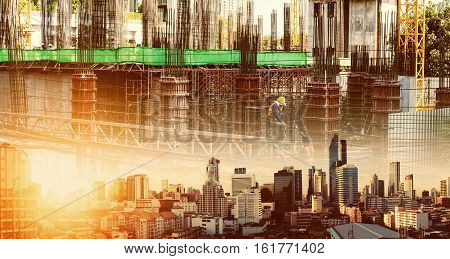 Double exposure, Bangkok city in sunset, with real estate site construction with workers