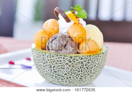 ice cream and melon in melon skin dish