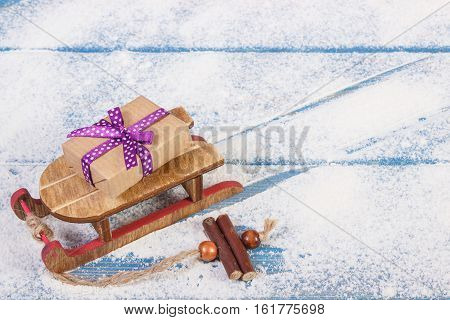 Wooden Sled And Wrapped Gift For Christmas Or Other Celebration, Copy Space For Text
