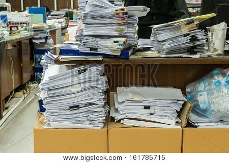 Busy messy and cluttered workplace full of documents