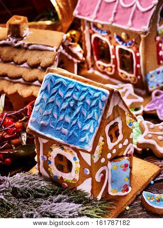 Make gingerbread hause for holiday christmas. Several Christmas ginger houses top view. Decorating Xmas table is fun holiday tradition. How to Make Decorating Party for holiday.