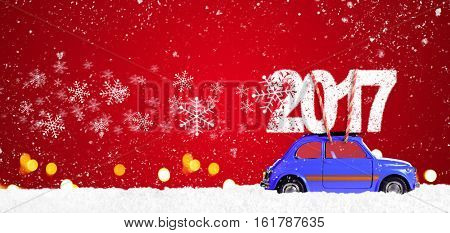 Blue retro toy car delivering Christmas or New Year 2017 on festive red background