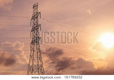 Electric Pole On Sunset Sky And Cloud Background.