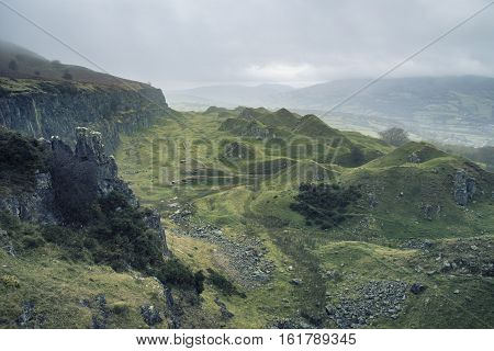 Stunning Cross Processed Landscape Image Of Abandoned Quarry Taken Over By Nature In Autumn Fall At