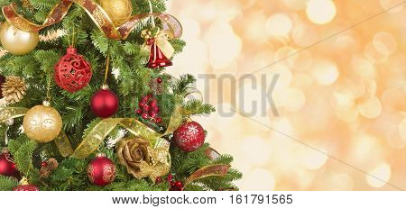 Decorated Christmas tree on abstract lights background
