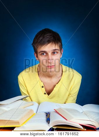 Sad and Tired Student on the Blue Background