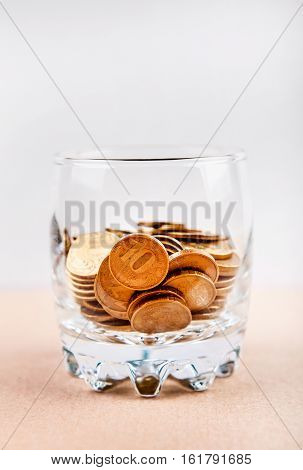 Russian Coins in the Glass on the Table