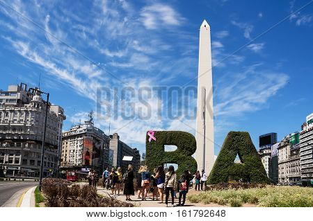 Buenos Aires, Argentina - October 30 2016: Obelisk and tourist in the center of Buenos Aires in a sunny day of spring