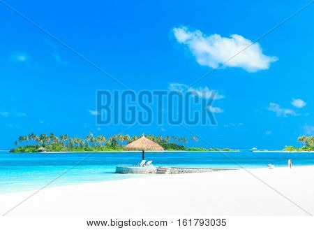Sea view from tropical beach with sunny sky.  Exotic summer beach with clouds on horizon. Ocean beach relax, outdoor travel