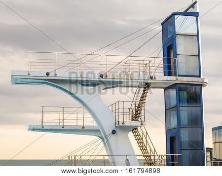 Diving tower and cloudy sky as background