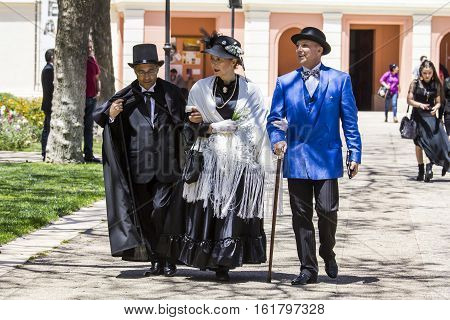 CAGLIARI, ITALY - May 29, 2016: Sunday at La Grande Jatte VIII Ed. At the Public Gardens - Sardinia - group of people parading in Victorian costumes