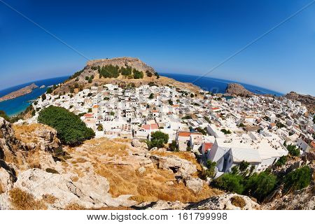 Beautiful cityscape of antique Lindos with white stone houses at sunny day, Rhodes,  Greece