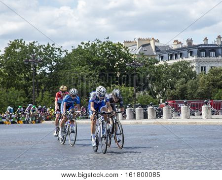 Paris France - July 24 2016: The feminine breakaway riding on Champs Elysees in Paris during the second edition of La Course by Le Tour de France 2016.