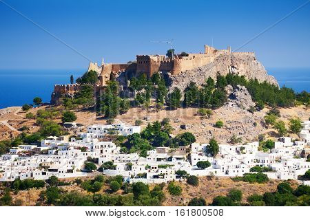 Beautiful cityscape of Lindos village and ancient Acropolis at sunny day, Greece