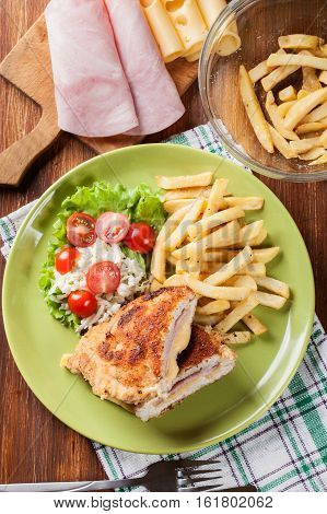 Cutlet Cordon Bleu With Pork Loin Served With French Fries And S