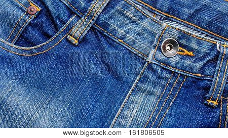 topview metal studs of blue jeans with pockets