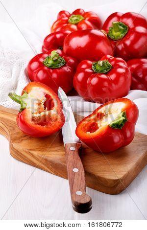 Pepper ratunda ( gogoshar ). Tomato shaped sweet pepper on cutting board. Red bell pepper capsicum or sweet pepper.