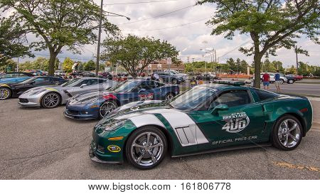 ROYAL OAK MI/USA - AUGUST 17 2016: Four Chevrolet Corvette cars including a 2010 Grand Sport NASCAR Brickyard 400 Pace Car at the Woodward Dream Cruise. Woodward is a National Scenic Byway.