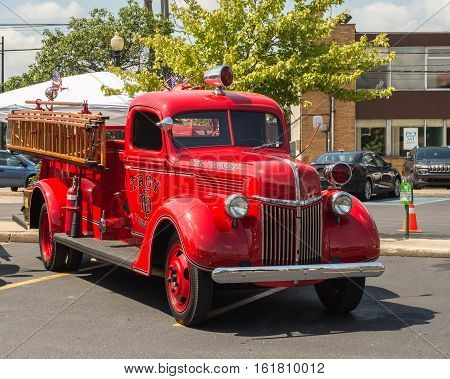 FERNDALE MI/USA - AUGUST 19 2016: Troy Township vintage Ford fire engine at the Emergency Vehicle Show at the Woodward Dream Cruise. Woodward is a National Scenic Byway.