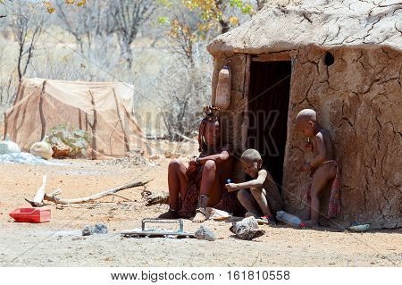 Himba Woman With Child In The Village