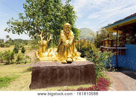Fat Monk Statue In Complex Pagoda Ekayana