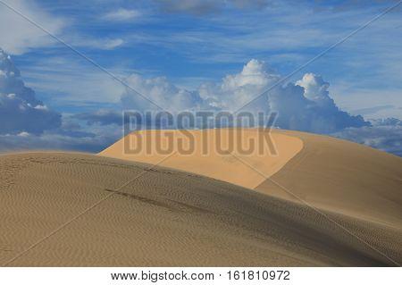 Amazing view of white sand dunes on the background of blue sky near Mui Ne place Vietnam