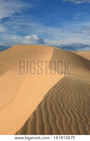 Landscape of scenic patterned dunes in the vast hot desert. Mui Ne Vietnam