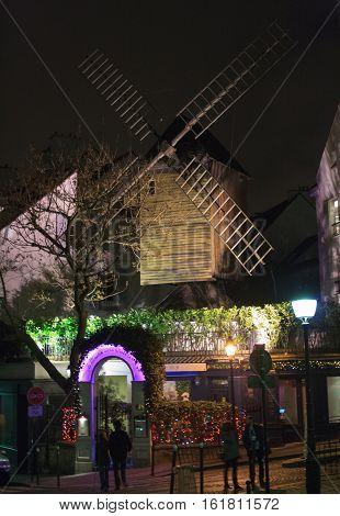 Paris, France, January 12, 2014. The famous restaurant Le moulin de la galette is historical place in Montmartre quarter of Paris.It has been painted by artists such as Pierre-August Renoir, Henri de Toulouse Lautrec, Vincent Van Gogh and Pablo Picasso.
