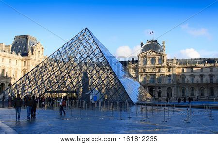 Paris, France, January 12, 2014. The view of the Passage Richelieu and the Pyramid of the Louvre. The Pyramid serves as the main entrance to the Louvre Museum in Paris. Paris is one of the most popular tourist destinations in Europe.