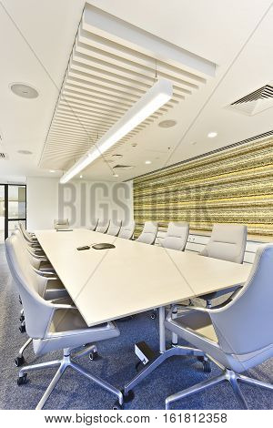Close view of a meeting room with a table and the lights turned on